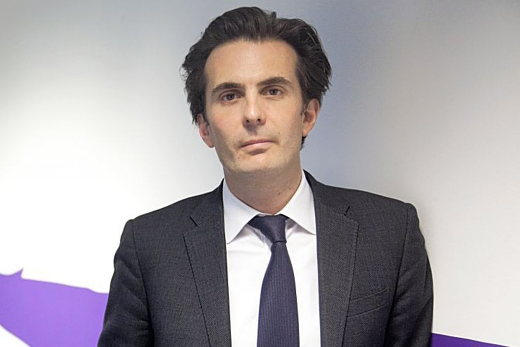 Yannick Bollore, director general and vice president of Havas SA, poses for a photograph at the company's headquarters in Paris, France, on Friday, Dec. 14, 2012. Havas SA, the French advertising company which is known for memorable advertising campaigns, including the 2009 commercials for Evian water that featured babies on roller skates. Photographer: Balint Porneczi/Bloomberg *** Local Caption *** Yannick Bollore